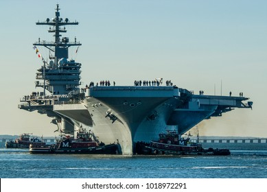 Newport News, Virginia / USA - :USS George H.W. Bush leaving Northrop Grumman Shipbuilding in Newport News, Virginia for Naval Station Norfolk, Norfolk, Virginia