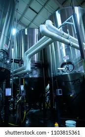 NEWPORT, OREGON - MAY 22, 2018 - Large brew vats at the Rogue Nation Brewery, Newport, Oregon