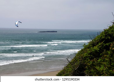 NEWPORT, OREGON - MAY 9, 2015 - Surfers use parasails to move through the incoming waves, near Newport on the  Oregon Coast