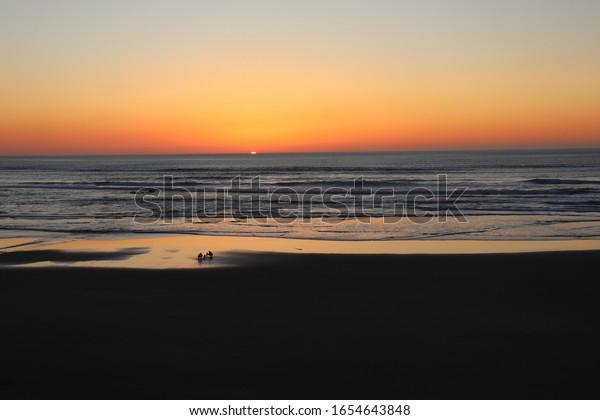Newport, Oregon / USA - Feb 20, 2020: Sunset at Moolack Shores.