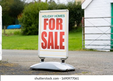 Newport, Pembrokeshire, Wales. UK. March 19th 2020. Poster Pavement Sign saying 'Holiday Homes For Sale'