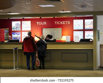 NEWPORT, RHODE ISLAND—SEPTEMBER 2017:  Tourists buying tickets for various tours from the Newport Gateway transportation and visitors center office.