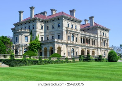 NEWPORT, RHODE ISLAND - AUGUST 8, 2013: The Breakers Mansion - a national historic landmark, built by Cornelius Vanderbilt of the Gilded Age, as seen on the Cliff Walk in Newport.
