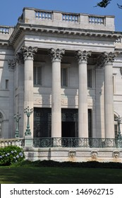 NEWPORT, RHODE ISLAND - JULY 19: The Marble House in Newport, Rhode Island as seen on July 19, 2013. It is a Gilded Age mansion and its temple-front portico is like that of the White House.