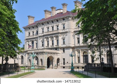 NEWPORT, RHODE ISLAND - JULY 19: The Breakers Mansion (a national historic landmark), built by Cornelius Vanderbilt of the Gilded Age, as seen on the Cliff Walk in Newport on July 19, 2013.