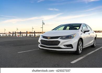 Newport, Rhode Island - March 20, 2017: View of a white 2017 Chevrolet Cruz near Newport, RI.