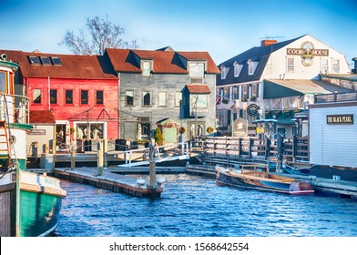 Newport, Rhode Island.  November 27, 2017.  Boats and various shops located at the harbor in Newport Rhode Island in the setting sun.
