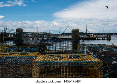 Newport, Rhode Island / United States - June 30, 2019: Lobster and crab traps stacked along the docks.