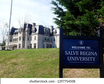 Newport, Rhode Island, USA - September 17, 2018: Welcome to Salve Regina University sign with Ochre Court in the background. The historic mansion was  commissioned by Ogden Goelet in 1892.
