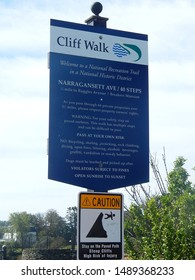 Newport, Rhode Island, USA - September 17, 2018: Welcome sign to the famous Newport Cliff Walk on Narragansett Avenue. Trail head cautions hikers of dangerous steep ocean cliffs and injury risks