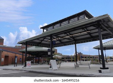 Newport, Rhode Island-September 2017: Medium close up of the bus terminal and bus stop outside the Newport Gateway Visitors Center, with a bus unloading passengers.