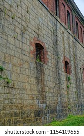 Newport, Rhode Island/USA- August 11, 2018: A vertical high definition image of loophole openings in the former Fort Adams' exterior walls.