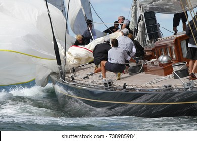 NEWPORT, RI - SEPTEMBER, 10: Unidentified crew members bring in spinnaker onboard J Class Yacht Hanuman during 2010 Newport Bucket Regatta on September 10, 2010 in Newport, RI.