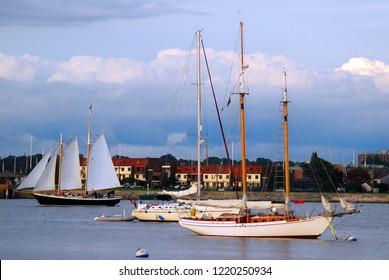 Newport, RI, USA September 15, 2008 A schooner with full sails cruises past other yachts in Narragansett Bay near Newport, Rhode Island