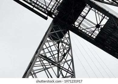 Newport Transporter Bridge, constructed in 1902 crosses the River Usk in Newport and is a grade 1 listed structure with cantilevered sections, the main girder truss gives it an overall length of 232m