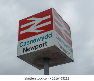 Newport, Wales - Feb 16, 2019: Newport British Rail sign against cloudy sky, Casnewydd in Welsh Language, shallow depth of field horizontal photography