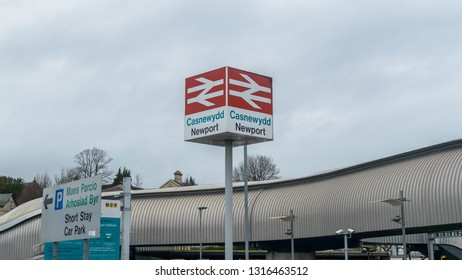 Newport, Wales - Feb 16, 2019: Newport British Rail sign, Casnewydd in Welsh Language, shallow depth of field horizontal photography