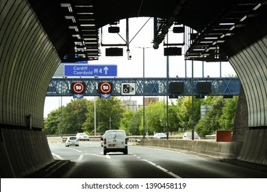 NEWPORT, WALES - SEPTEMBER 2018: White van on the M4 motorway about to enter the Brynglas Tunnels at Newport. The tunnels are a major bottleneck. A decision is due on a M4 relief road around Newport.