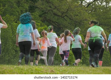 Newport Wales UK 05/19/2019  Charity fun run at Tredegar Park. Kolor Dash- Coloured powder paint similar to people being covered with powder at Holi Festival. Male, Female, young, teen elderly runners