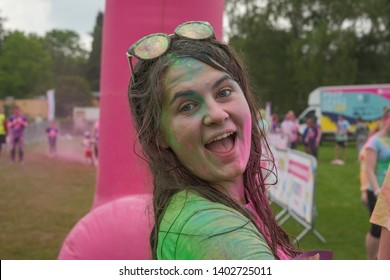 Newport Wales UK 05/19/2019  Charity fun run at Tredegar Park. Kolor Dash- Coloured powder paint similar to people being covered with powder at a Holi Festival. Young female covered in powder paint.
