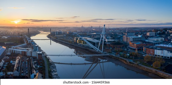 Newport, Wales, UK – November 18, 2019: An aerial view at sunrise of Newport city centre, south wales United Kingdom, taken from the River Usk