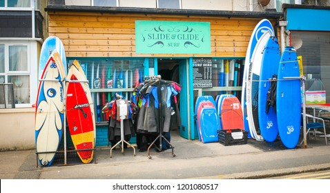 Newquay, Cornwall, England - July 18, 2018: Surfing equipment for rent in Newquay, major tourist area and surfing sport in Cornwall, England