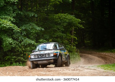 NEWRY, MAINE, USA - JULY 15, 2011:1979 Saab 99 drives out of the woods at the 2011 New England Forest Rally. The Team of Sorensen and Strait race in the vintage 1979 Saab.
