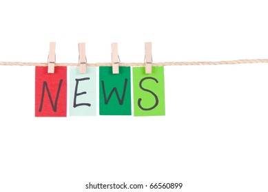 News, Colorful words hang on rope by wooden peg