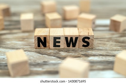 news concept on wood cubes