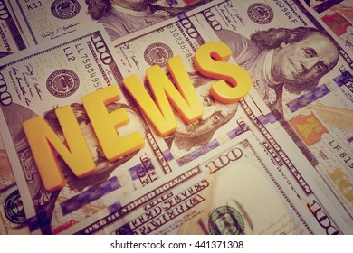 News concept. Yellow letters on a background of US dollars