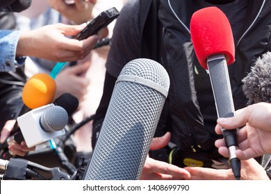 News conference or media interview. Public relations - PR.