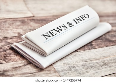 News & Info in newspaper and newsletter on a table