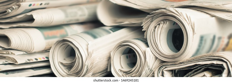 News newspapers stacked and folded, toning