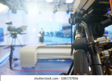 The news presenter reads the text on the teleprompter. Camera in the office. TV studio.