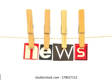 News in wooden clothes pegs