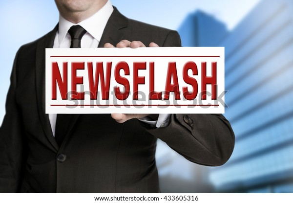 newsflash sign is held by businessman.