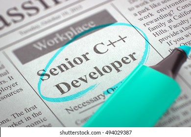 Newspaper with Classified Advertisement of Hiring Senior C Developer. Blurred Image. Selective focus. Hiring Concept. 3D.