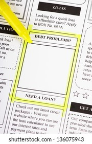 A newspaper clipping from the classified adverts section with a highlighted section around debt problems as a concept for personal finance difficulties and solutions