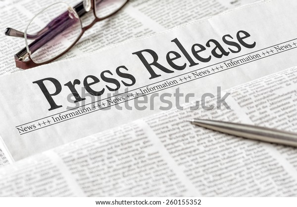 A newspaper with the headline Press Release