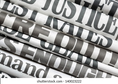 Newspaper headlines side on in a stack of daily newspapers