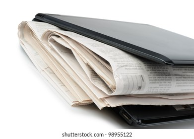 Newspaper and a laptop. The concept of e-news