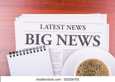 The newspaper LATEST NEWS with the headline BIG NEWS  and coffee