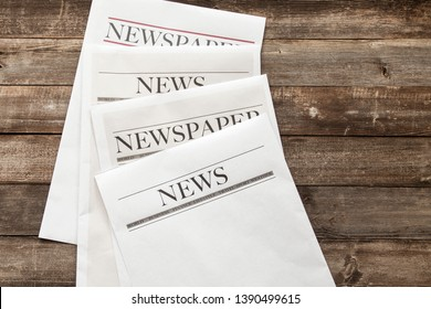 Newspaper on the wooden background