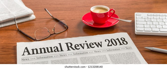 A newspaper on a wooden desk - Annual review 2018