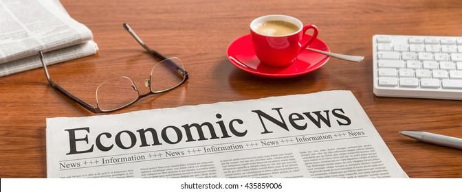 A newspaper on a wooden desk - Economic News