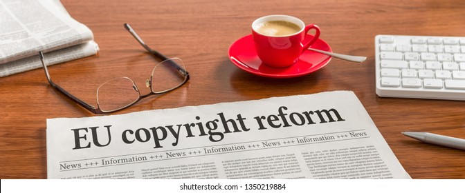 A newspaper on a wooden desk -EU copyright reform