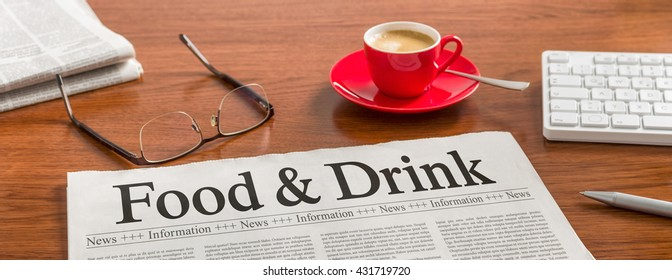 A newspaper on a wooden desk - Food and Drink