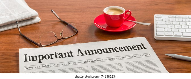 A newspaper on a wooden desk - Important announcement