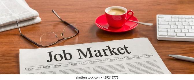 A newspaper on a wooden desk - Job Market