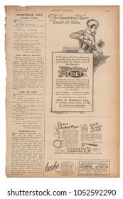 Newspaper page with english text and advertising pictures. Vintage magazine from 1923